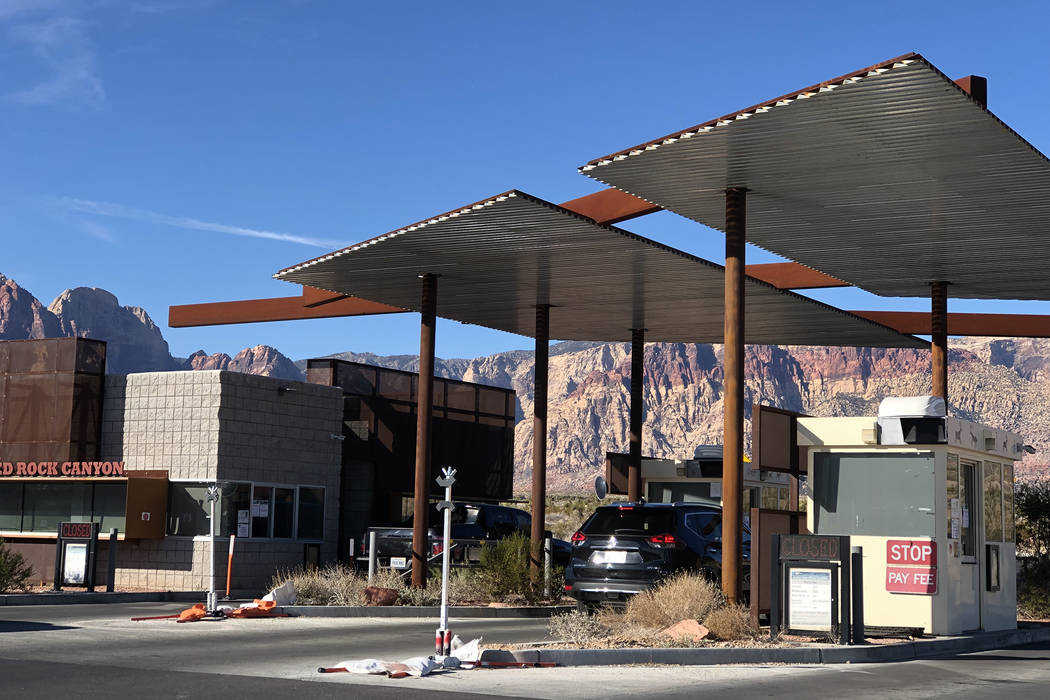 Guests enter the scenic loop at Red Rock National Conservation Area, which was accessible despite fee stations being closed on Saturday,, Dec. 22, 2018, during a partial government shutdown. (Rio ...