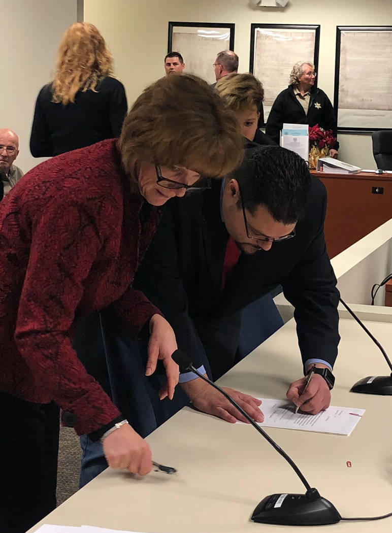 Special to the Pahrump Valley Times Leo Blundo is pictured signing a declaration form after taking his oath of office as the new representative for Nye County Commission District 4.