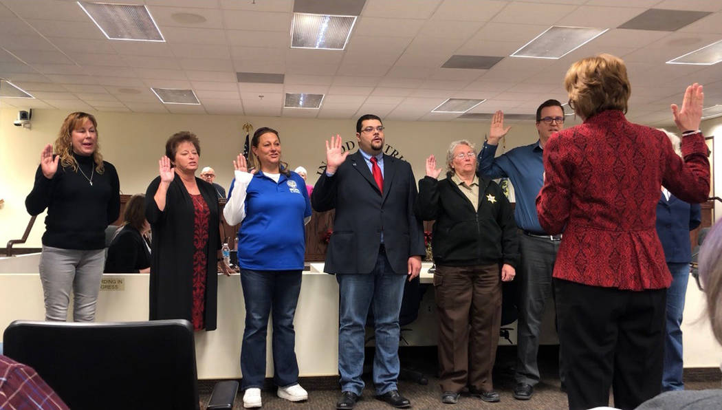 Special to the Pahrump Valley Times The newest crop of Nye County officials take part in a swearing-in ceremony on Dec. 18. Nye County Commissioner-elect Leo Blundo is pictured fourth from left.