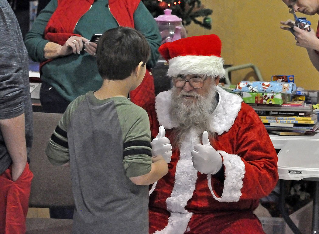 Horace Langford Jr./Pahrump Valley Times Santa Claus made a special trip to the Pahrump Valley for Christmas Day, dropping in at the Community Christmas Brunch to bring smiles of joy to both child ...