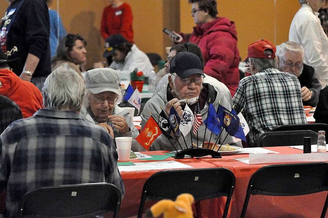 Horace Langford Jr./Pahrump Valley Times The Holiday Task Force makes sure to provide area veterans with a place of honor at each of their community meals. The veterans table at the Community Chr ...