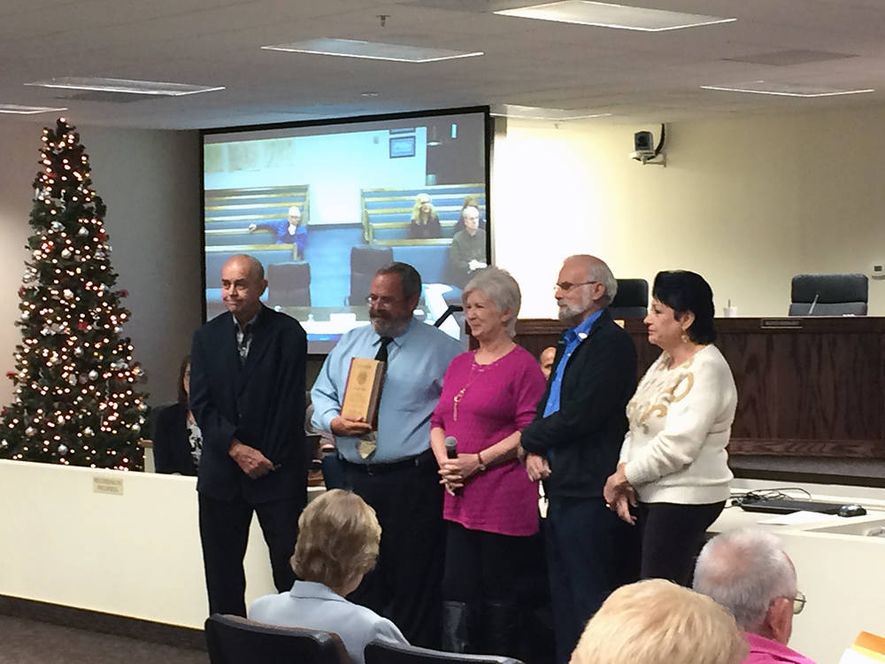 Robin Hebrock/Pahrump Valley Times A plaque was presented to Dan Schinhofen, second from left, during his final commission meeting in his official capacity, commemorating his eight years of servic ...