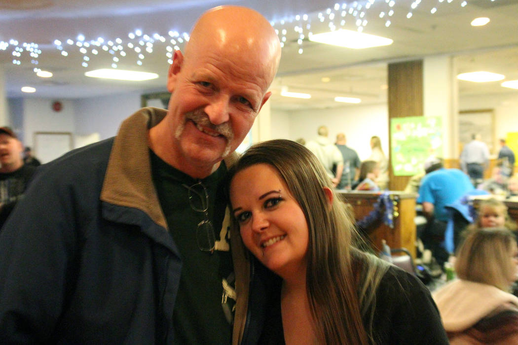 Jeffrey Meehan/Times-Bonanza & Goldfield News Nye County Sheriff's Office Sgt. Duane Downing (left) stands next to his daughter Deidra Gromis, (right) at a welcome home party at the Tonopah Conven ...