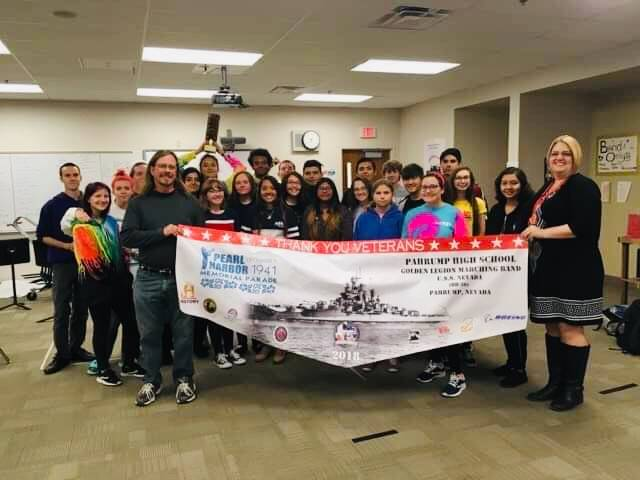 Special to the Pahrump Valley Times Jennifer Ehrheart, principal of the Pahrump Valley High School, and high school music instructor stand with the school's marching band members following the gro ...