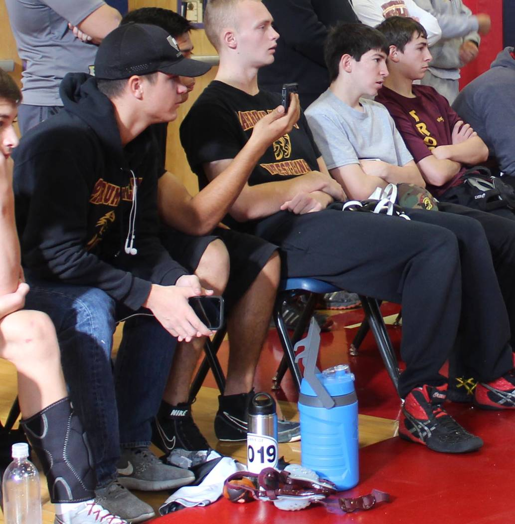 Tom Rysinski/Pahrump Valley Times Senior Dylan Grossell, left, watches with Pahrump Valley teammates as the Trojans wrestle Bonanza on Dec. 15 at the Patriot Duals in Henderson.