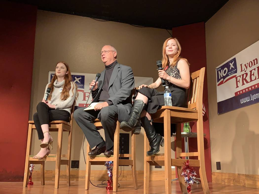 """Chuck Muth, center, moderated a Q&A Thursday night in Mound House, Lyon County, with two legal sex workers on a possible move to ban legal prostitution in the county. """"Ruby Rae,"""" left, and """"Alice ..."""