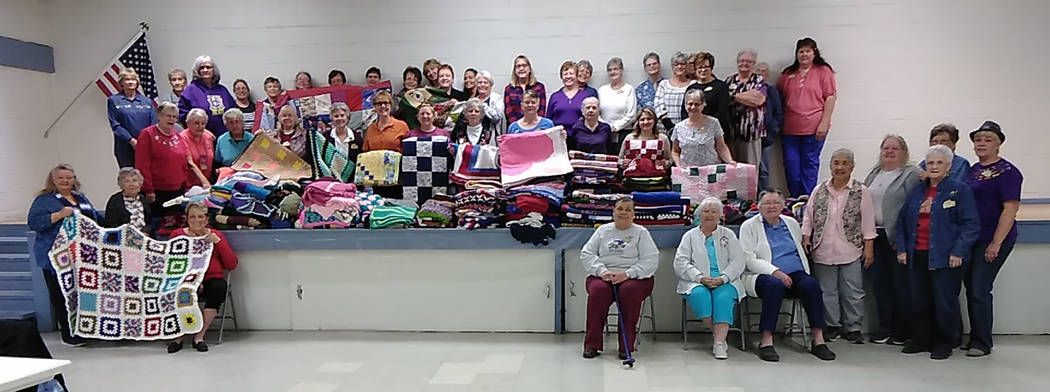 Selwyn Harris/Pahrump Valley Times Members of Pahrump's Shadow Mountain Quilters display cold weather accessories, bound for area senior citizens enrolled in the Pahrump Senior Center's Meals on W ...