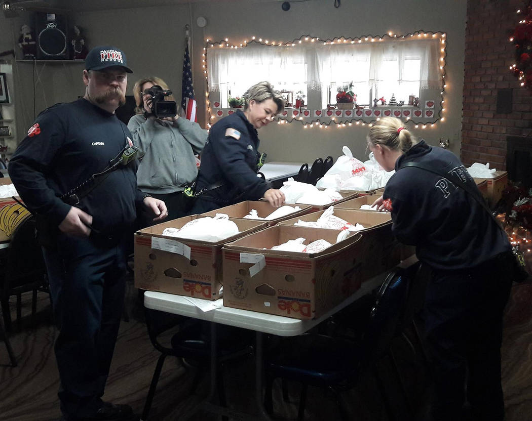 Special to the Pahrump Valley Times Pahrump Firefighters/EMT's prepare to deliver hot holiday meals to more than 100 home bound area residents enrolled in the Pahrump Senior Center's Meals on Whee ...