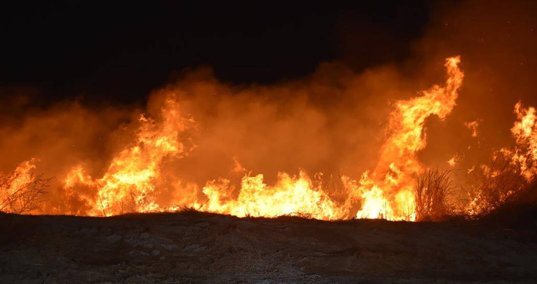 Special to the Pahrump Valley Times Pahrump fire crews were dispatched to the area of Gamebird Road and Malibou Street early Friday morning December 28, for a reported wind swept brush fire just b ...