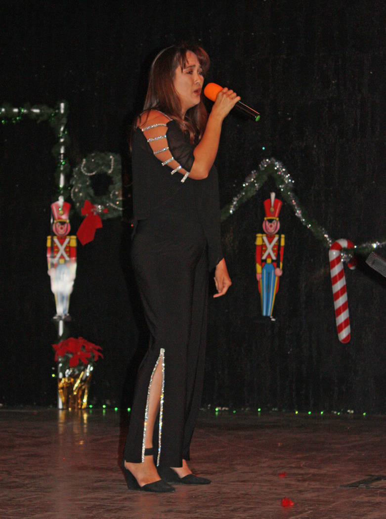 Robin Hebrock/Pahrump Valley Times Lisa Chamlee is pictured signing at the Nevada Silver Tappers Christmas Benefit in Dec. 2018. She plans to continue her involvement in the community while servin ...