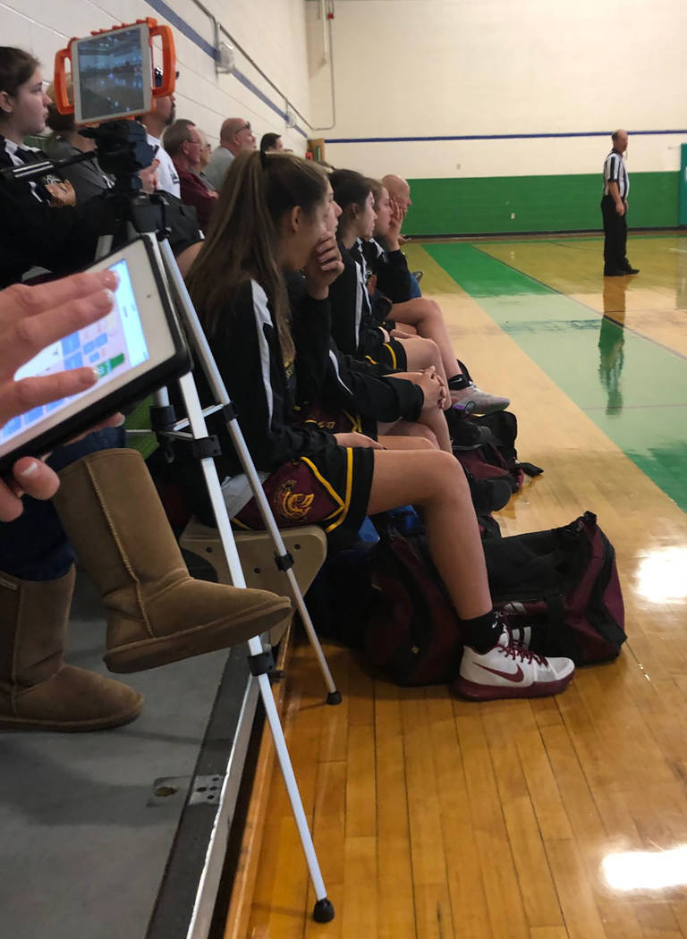 Tom Rysinski/Pahrump Valley Times Pahrump Valley girls basketball players watch Virgin Valley take on Valley while waiting for their game against Fullerton, California, to start Friday at Green Va ...