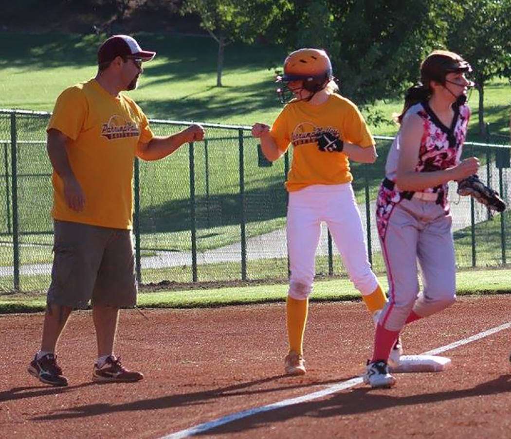 Cassondra Lauver/Special to the Pahrump Valley Times Rich Lauver congratulates Evandy Murphy after a triple during a U16 softball game against the Southern Utah Rebels.