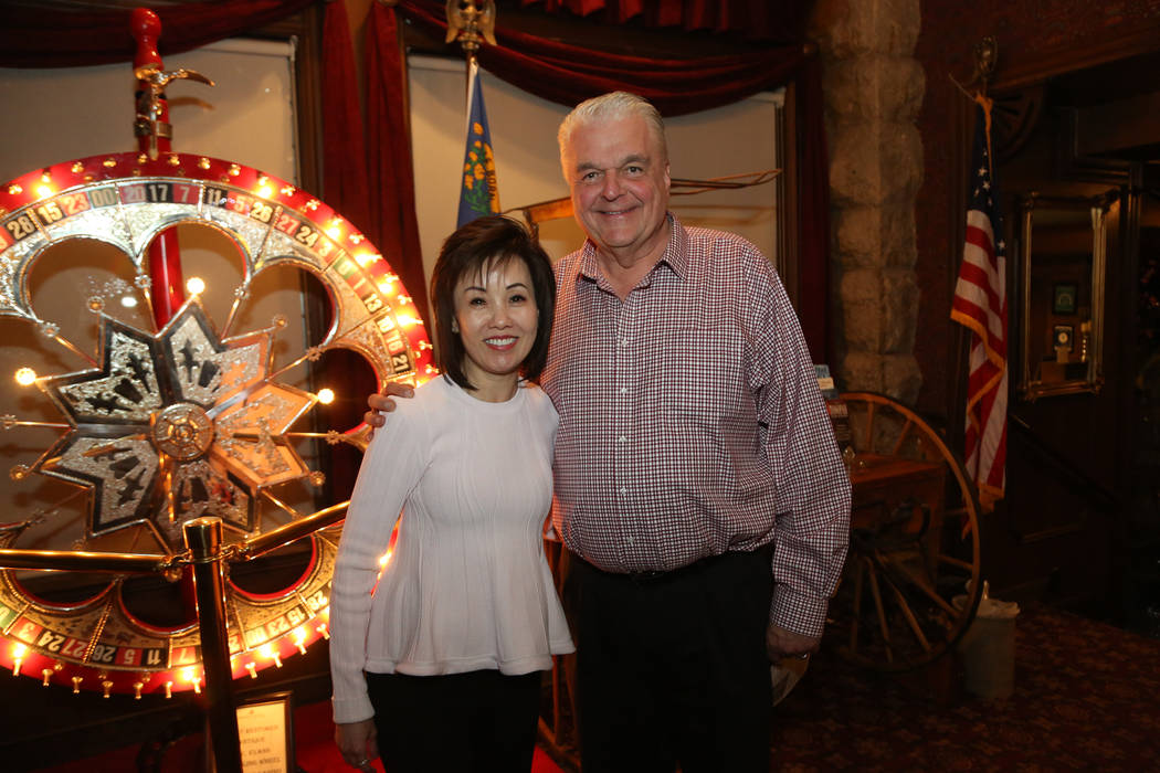 Edison Graff/Speical to the Pahrump Valley Times Kathy Sisolak, formerly Kathy Ong, (left) with her new husband Gov. Steve Sisolak (rght) at the Mizpah Hotel in Tonopah. The newly married couple s ...