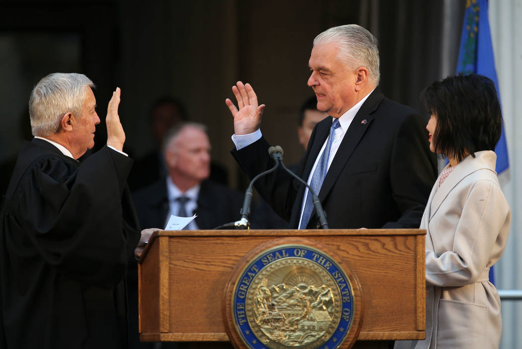 Cathleen Allison/Las Vegas Review-Journal Steve Sisolak is sworn in as Nevadas 30th governor on Jan. 7, 2019. Sisolak replaces former Gov. Brian Sandoval.