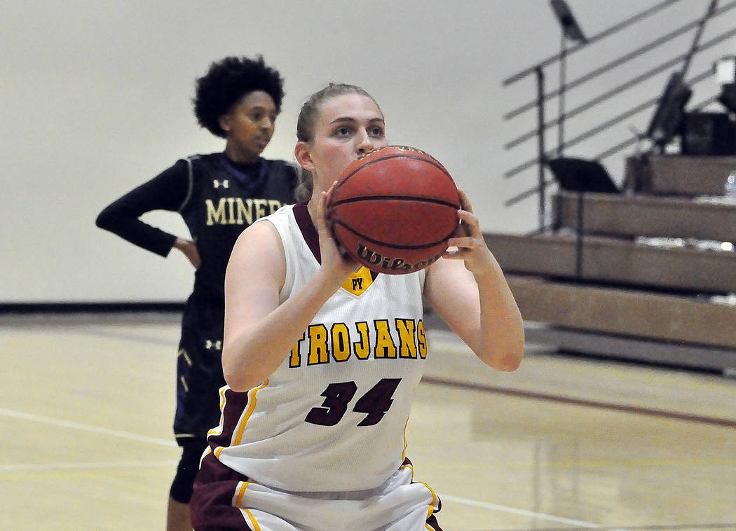 Horace Langford Jr./Pahrump Valley Times Junior forward Kylie Stritenberger lines up a free throw during a December game against Sunrise Mountain. Stitenberger scored 8 points as the Trojans defea ...