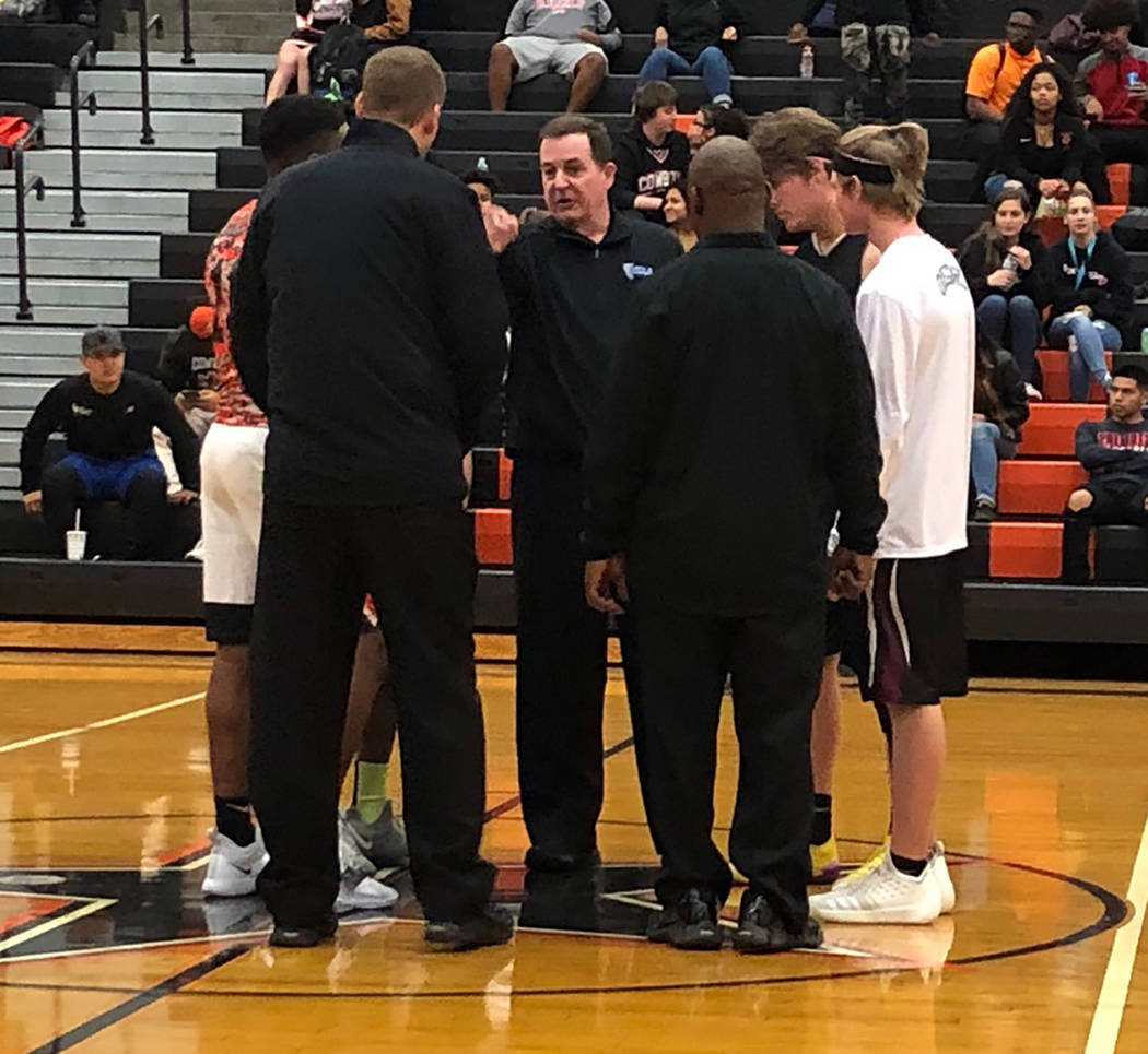 Tom Rysinski/Pahrump Valley Times Captains Brayden Severt and Grant Odegard and Chaparral's captains meet with the officials before Tuesday night's game against Chaparral in Las Vegas.