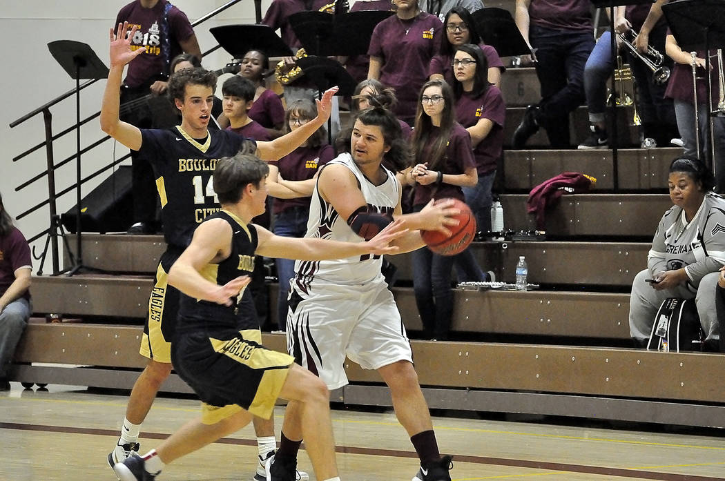 Horace Langford Jr./Pahrump Valley Times Pahrump Valley senior Eric Toomer gets double-teamed by Boulder City defenders during Friday night's game in Pahrump.