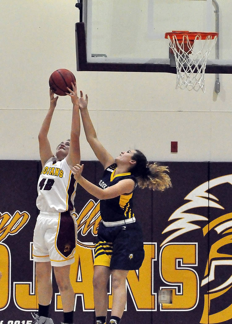 Horace Langford Jr./Pahrump Valley Times Sophomore forward Kate Daffer scored 12 points to lead Pahrump Valley during the Trojans' 31-29 loss to Boulder City on Friday in Pahrump.
