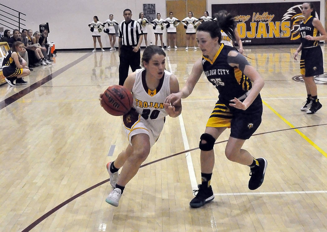 Horace Langford Jr./Pahrump Valley Times Pahrump Valley sophomore guard Maddy Souza looks to drive past Boulder City's Hannah Estes during Friday night's game in Pahrump.