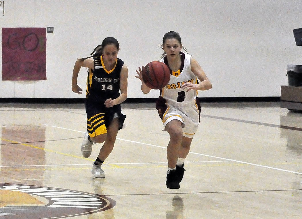 Horace Langford Jr./Pahrump Valley Times Freshman guard Tayla Wombaker runs the floor pursued by Boulder City's Keely Alexander during the Eagles' 31-29 win over the Trojans on Friday night.