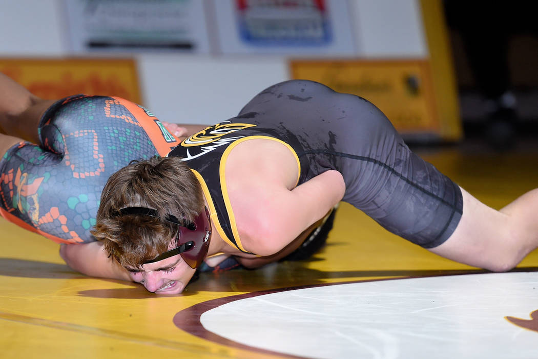Peter Davis/Special to the Pahrump Valley Times Pahrump Valley junior Donnie Miller takes control of Mojave's Jaylen McGee on his way to a 15-6 major decision in their 120-pound bout Thursday nigh ...