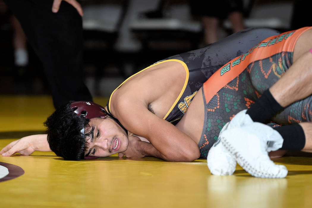 Peter Davis/Special to the Pahrump Valley Times Freshman Henry Amaya first-period pin of Joseph Lojero at 132 pounds Thursday night gave Pahrump Valley a 28-0 lead over Mojave in their Sunset Leag ...