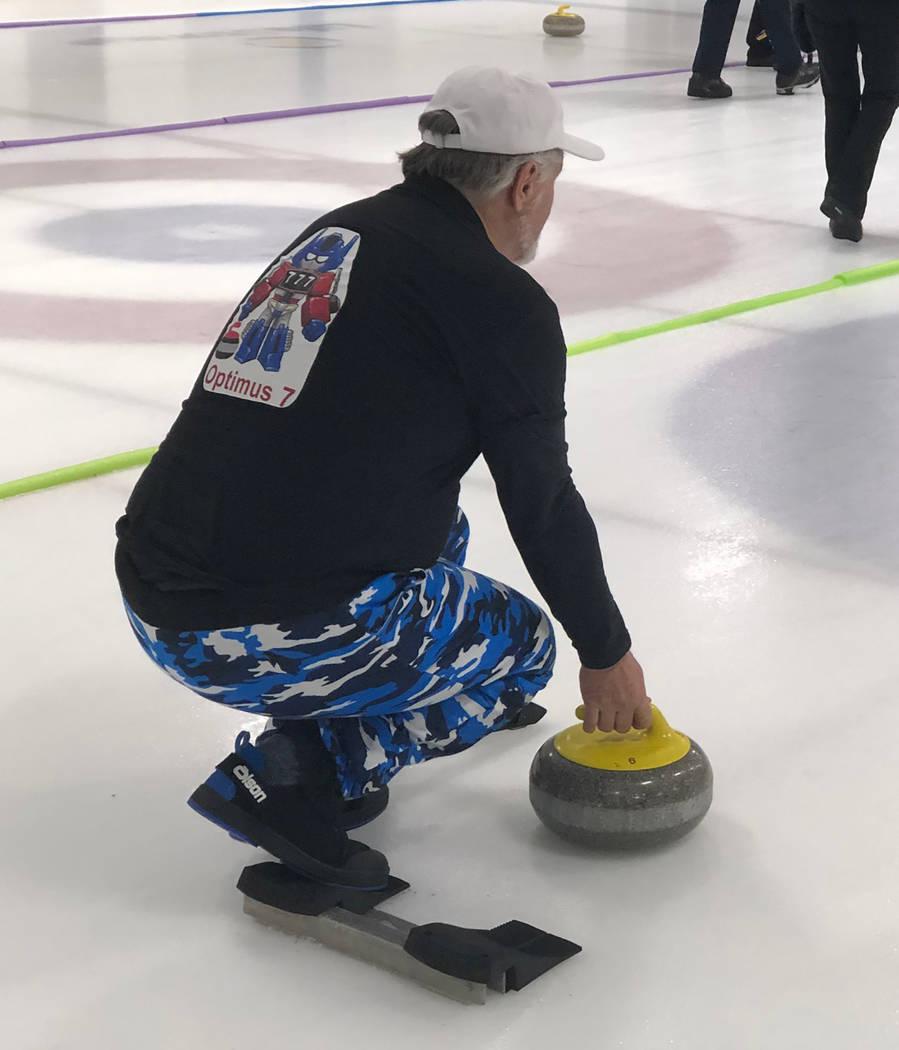 Tom Rysinski/Pahrump Valley Times Tom Duryea of Pahrump prepares to throw a stone during the Sin Sity Spiel on Jan. 11 at the Las Vegas Ice Center.