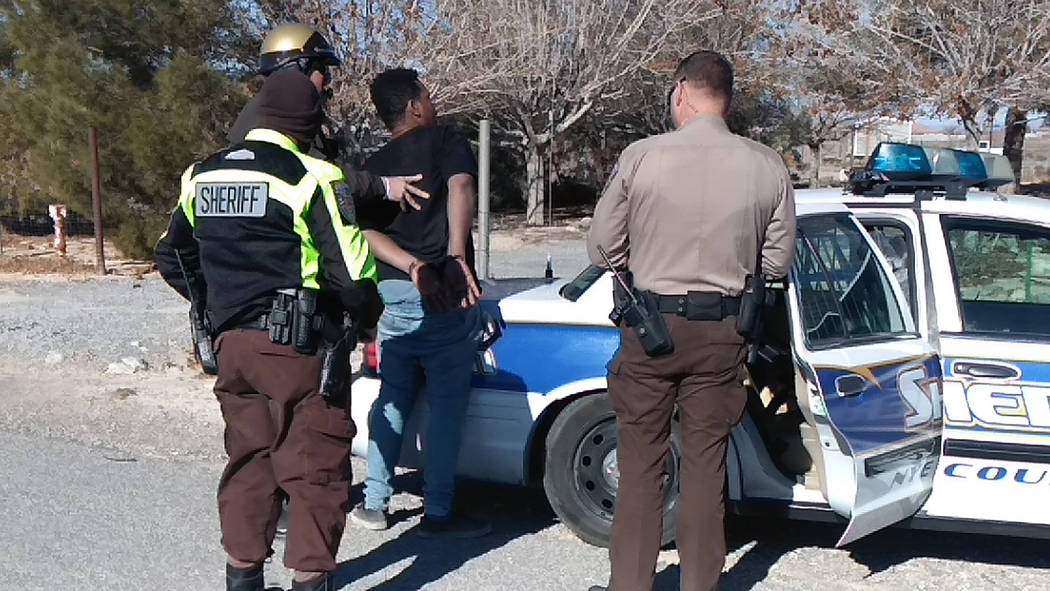 Selwyn Harris/Pahrump Valley Times Nye County Sheriff's deputies prepare to transport suspect Christopher Graham after the man was arrested on a New Year's Day DUI and hit and run charge. Gra ...