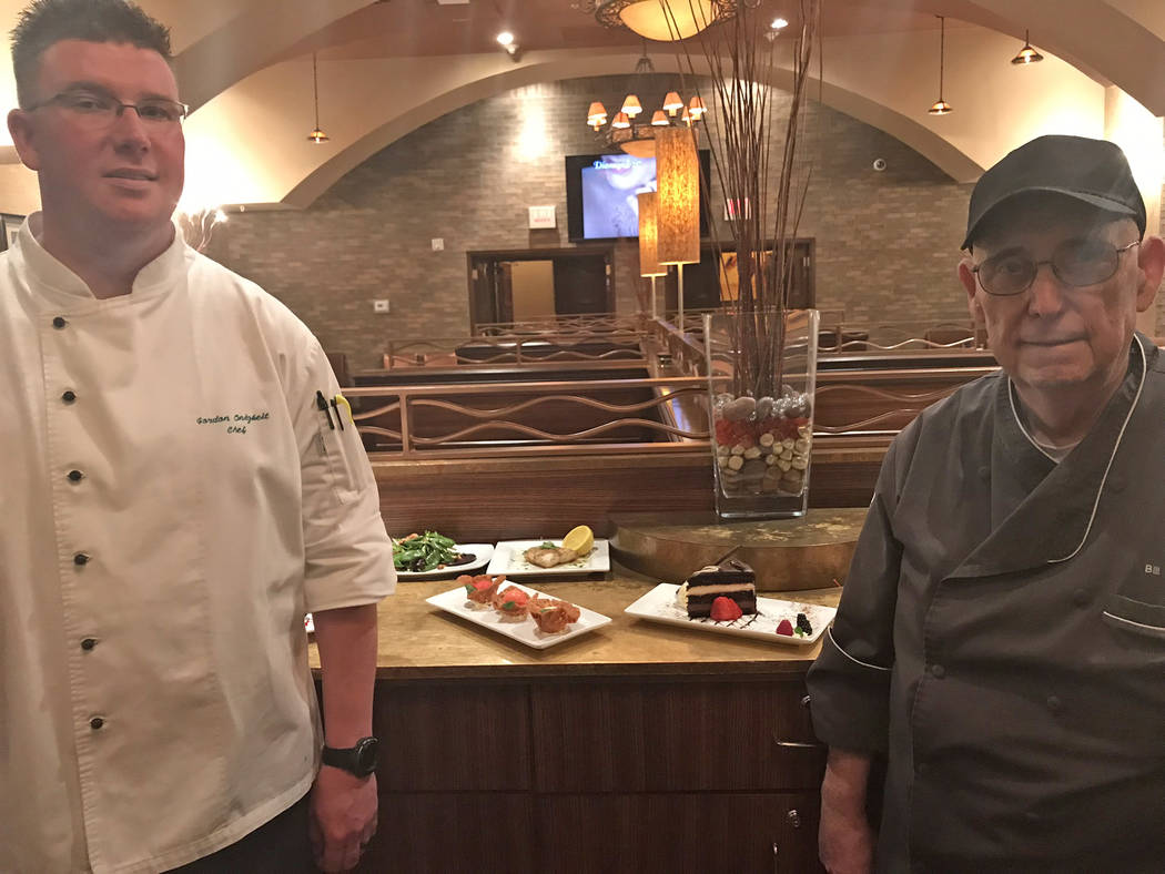 Jeffrey Meehan/Pahrump Valley Times Gordon Onigkeo, chef at Stockman's Steakhouse (left), stands with Bill Bitzer, also a chef at Stockman's, stand at the steakhouse on Jan. 10, 2019. The duo rece ...