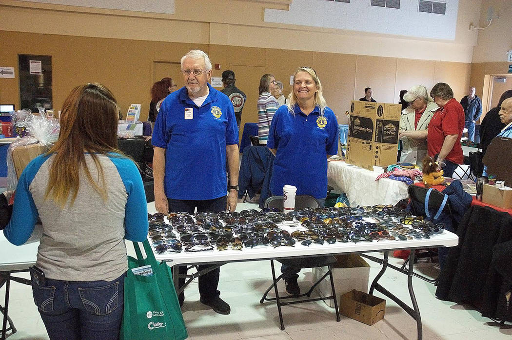 Horace Langford Jr./Pahrump Valley Times At the Nye County Social Services Fair, Pahrump Valley Lions Club members Bill Newyer and Brigitte Dubin spent time detailing the club's many charitable en ...