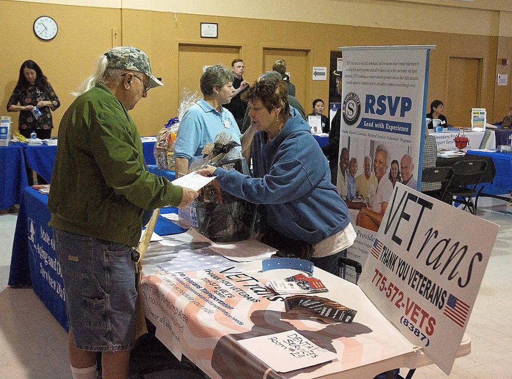 Horace Langford Jr./Pahrump Valley Times - Sandy Jennings is seen explaining the VETrans Bus Service to a local resident during the Social Services Fair hosted Jan. 16.