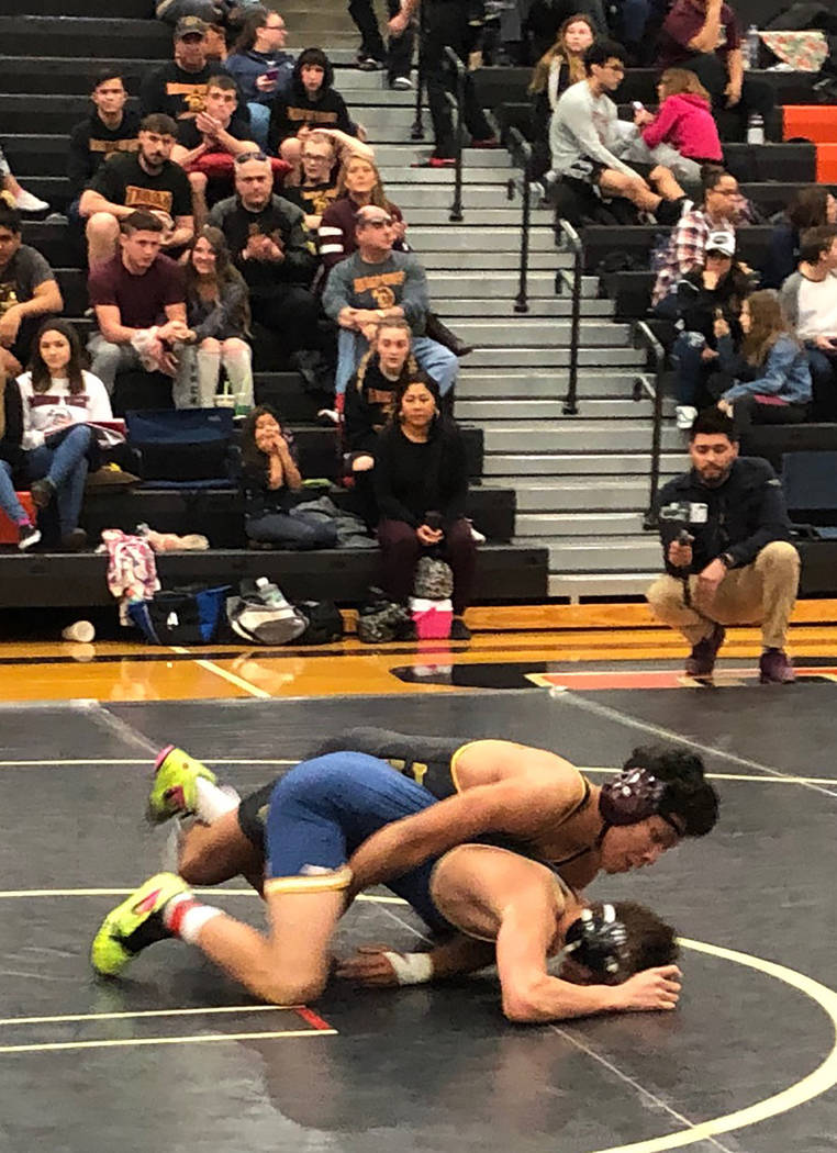 Tom Rysinski/Pahrump Valley Times Senior Isaak Cruz controls Steven Anzalone of Enterprise, Utah, during their third-place bout at 145 pounds Saturday at the Chaparral Invitational in Las Vegas.