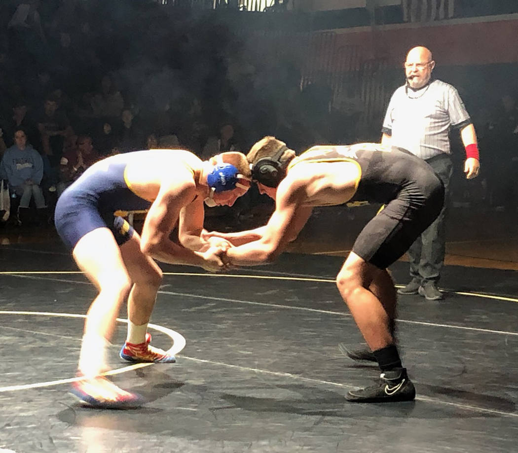 Tom Rysinski/Pahrump Valley Times Pahrump Valley senior Tristan Maughan, right, battles Benjamin Rowley on Saturday during the 160-pound final at the Chaparral Invitational in Las Vegas.