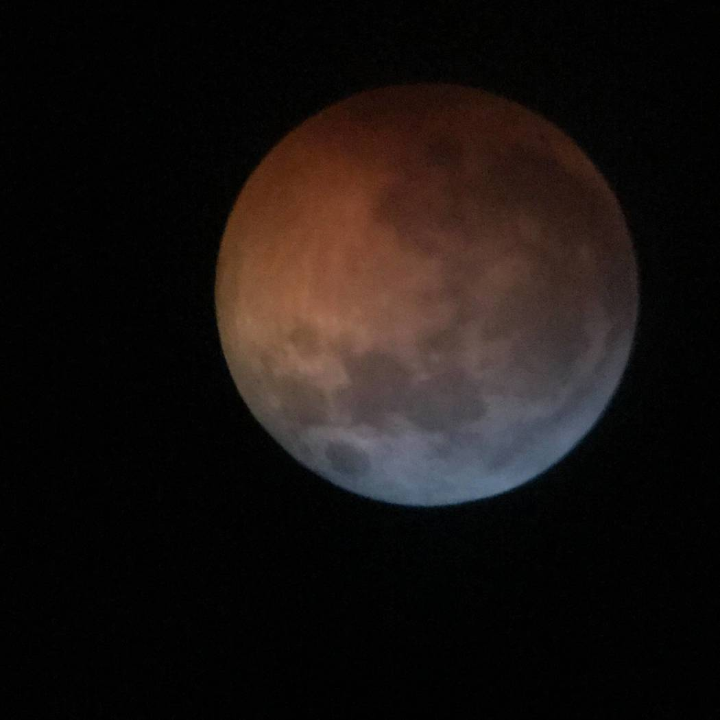 """Pearl Lowell/Special to the Pahrump Valley Times The total lunar eclipse was visible throughout Pahrump just before 9 p.m. on Sunday. The event bought about what is commonly known as the """"super bl ..."""