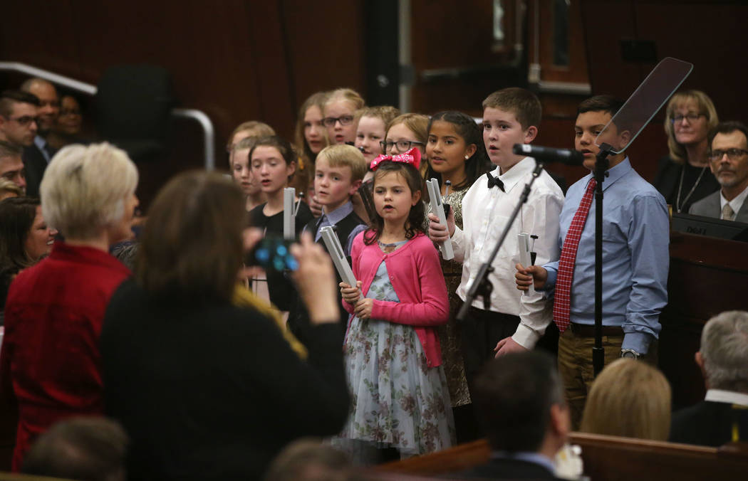 The Mark Twain Elementary School choir sings before Nevada Gov. Steve Sisolak delivers his State of the State address to the Legislature in Carson City, Nev., on Wednesday, Jan. 16, 2019. (Cathlee ...