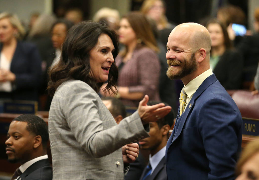 Freshman Assemblywoman Alexis Hansen, R-Sparks, talks with former Assemblyman Justin Watkins before the start of Nevada Gov. Steve Sisolak's State of the State address in Carson City, Nev., ...