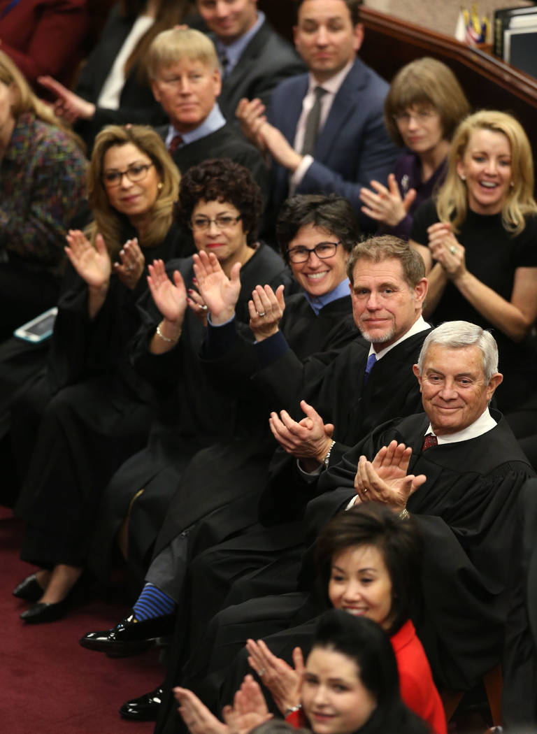 Nevada Supreme Court Justices, from top center, Mark Gibbons, Abbi Silver, Elissa Cadish, Lidia Stiglich, Ron Parraguirre and Chief Justice James Hardesty applaud a member of the crowd during Gov. ...