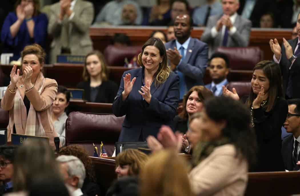 Supporters, including Assemblywoman Shea Backus, D-Las Vegas, center, applaud during Nevada Gov. Steve Sisolak's State of the State address to the Legislature in Carson City, Nev., on Wedne ...