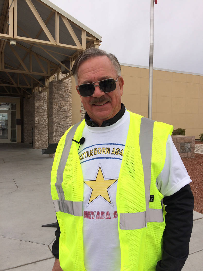 Robin Hebrock/Pahrump Valley Times New Nevada State Movement chairman Robert Thomas III poses before the Nye County Courthouse.