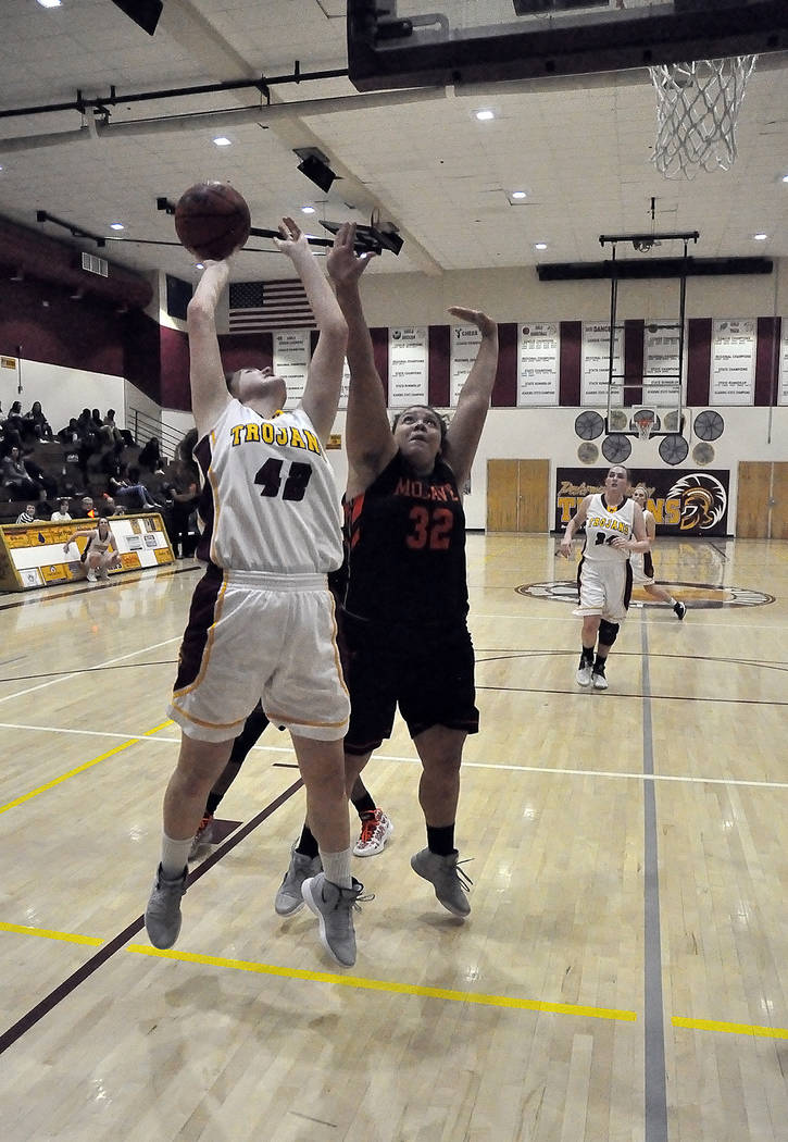 Horace Langford Jr./Pahrump Valley Times Sophomore forward Kate Daffer goes up for a shot while Mojave junior Jasmine Kaufman defends Tuesday night in Pahrump. Daffer's 9 points led the Trojans in ...