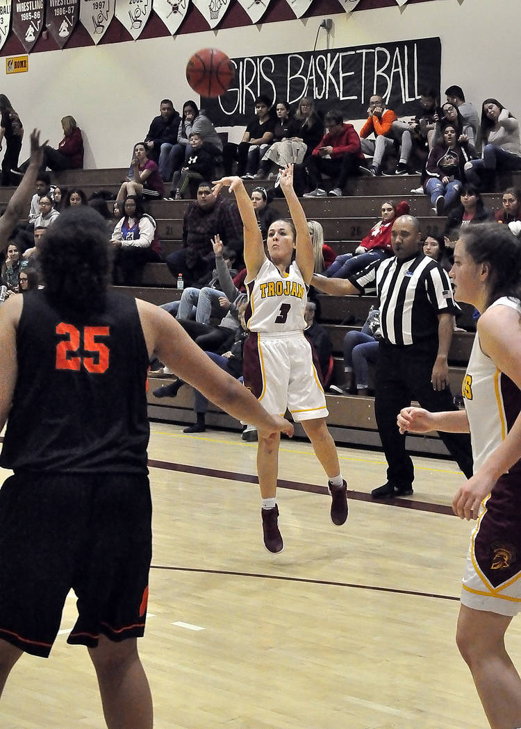 Horace Langford Jr./Pahrump Valley Times Pahrump Valley's Virginia Weir launches a 3-point shot against Mojave during Tuesday night's game in Pahrump.