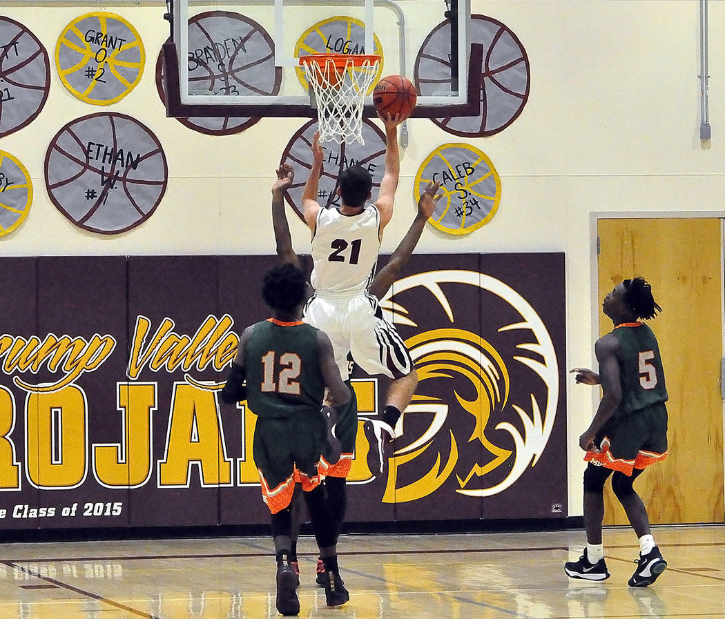 Horace Langford Jr./Pahrump Valley Times Pahrump Valley senior Garrett Ward drives to the basket against Mojave during Tuesday night's game in Pahrump.