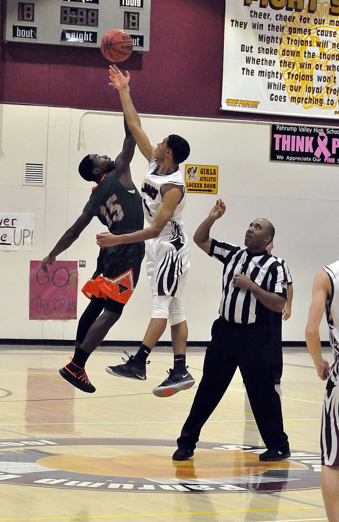 Horace Langford Jr./Pahrump Valley Times Senior Ethan Whittle wins the opening jump ball for Pahrump Valley on Tuesday night against Mojave in Pahrump.