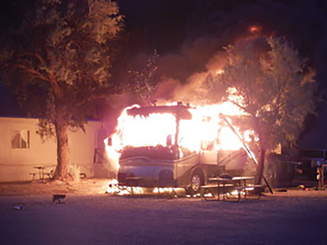 Alison Calkins/Special to the Pahrump Valley Times The explosion of the RV's propane tank shot a July Fourth's worth of hot, glowing embers into the night sky.