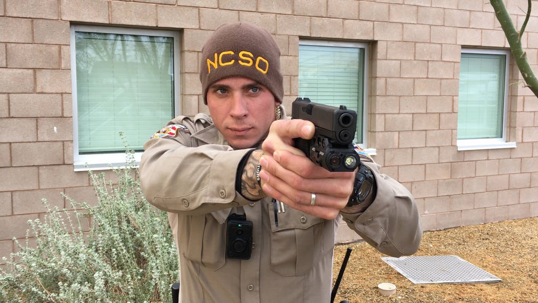 Viridian/Special to the Pahrump Valley Times (still shot from video clip) A Nye County Sheriff's Office deputy is pictured holding a firearm with new weapon-mounted camera technology that the offi ...