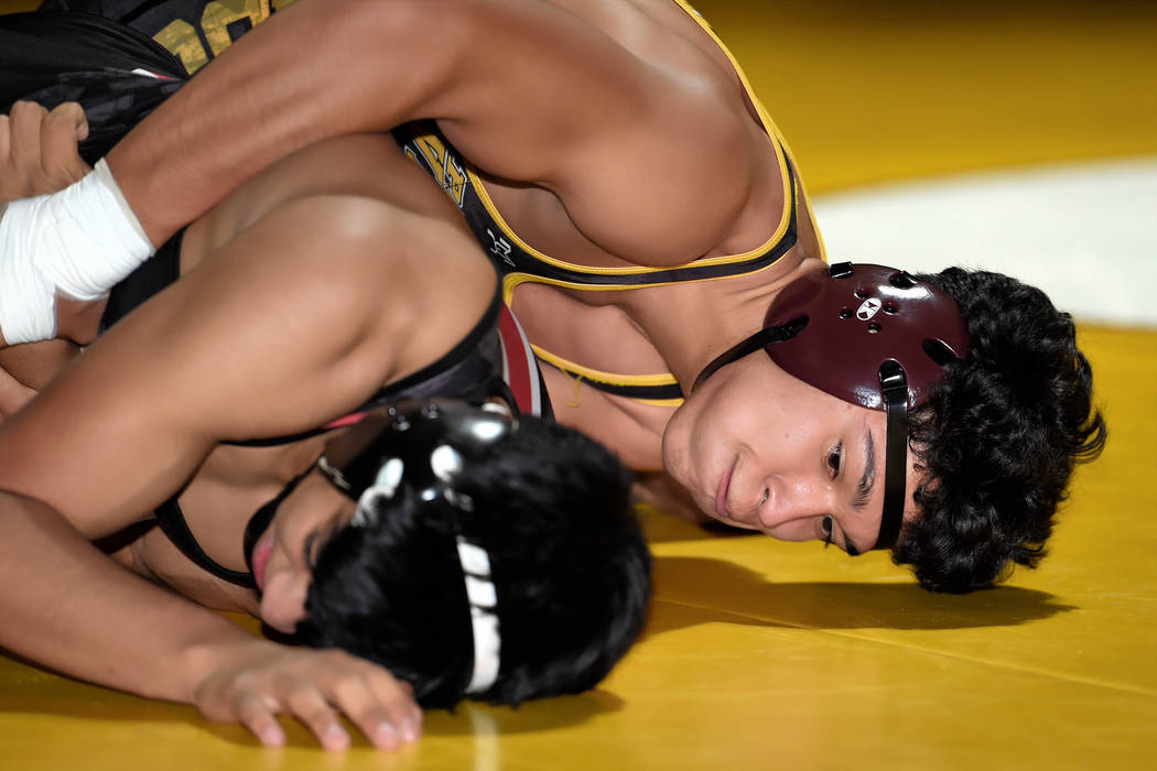 Peter Davis/Special to the Pahrump Valley Times Pahrump Valley senior Isaak Cruz takes control of Juan Vargas of Western on his way to a third-period pin at 145 pounds Wednesday night during the T ...