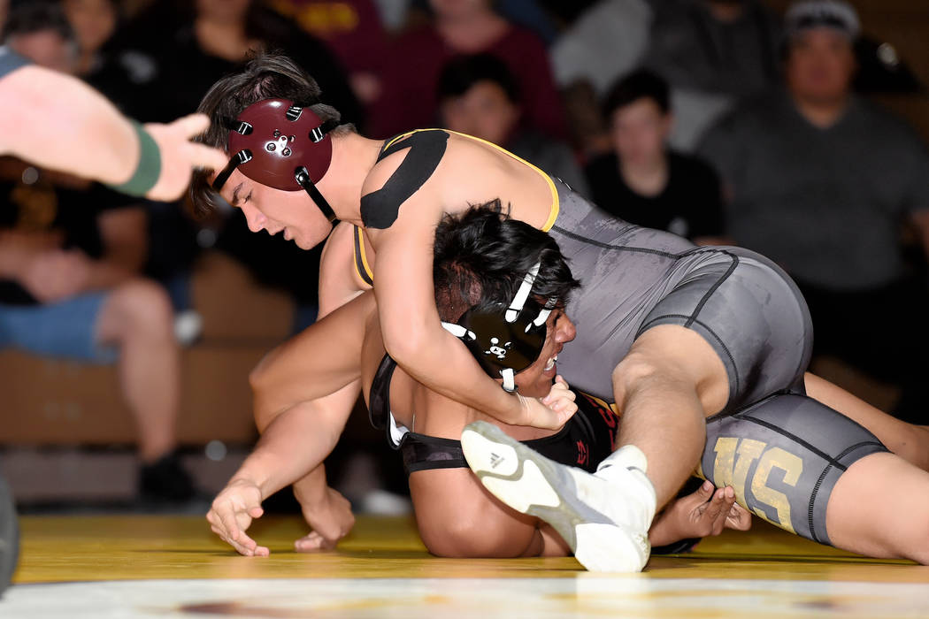 Peter Davis/Special to the Pahrump Valley Times Pahrump Valley senior Dylan Grossell battles Western freshman Jesus Perez at 152 pounds on Wednesday night in Pahrump. Grossell recorded a second-pe ...