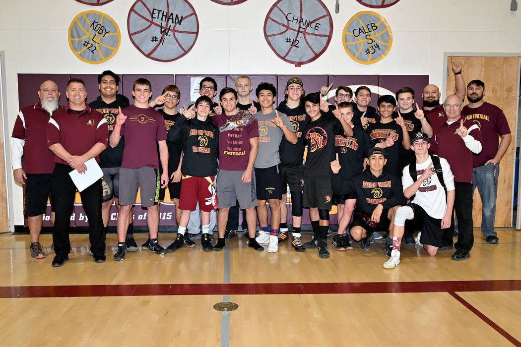 Peter Davis/Special to the Pahrump Valley Times Pahrump Valley High School wrestlers and coaches celebrate their second consecutive Sunset League championship on Wednesday night in Pahrump.
