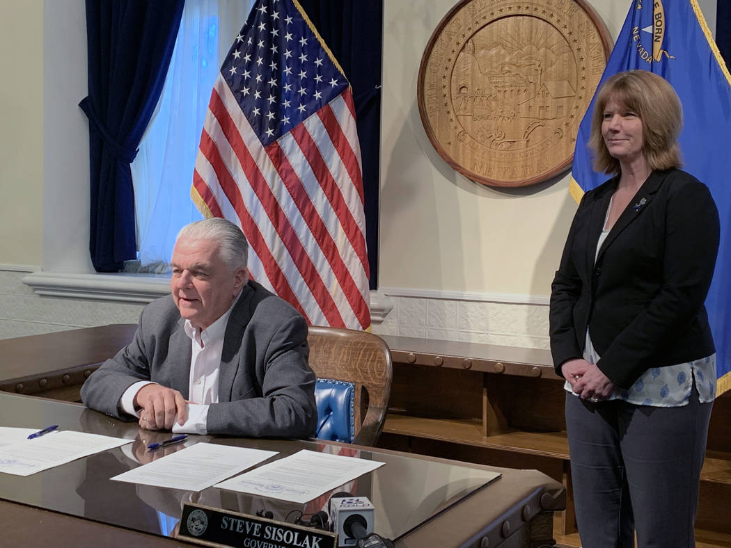 Gov. Steve Sisolak speaks Friday after signing an order creating an advisory panel to draft legislation for Cannabis Compliance Board to regulate the industry. To his left is Melanie Young, execut ...