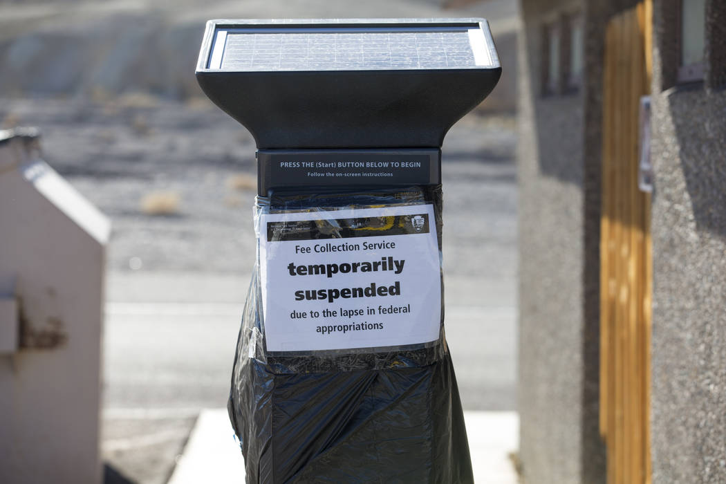 A temporarily suspended pay station affected by the partial government shutdown is seen at Zabriskie Point at Death Valley National Park in Calif., on Friday, Jan. 4, 2019. Richard Brian Las Vegas ...
